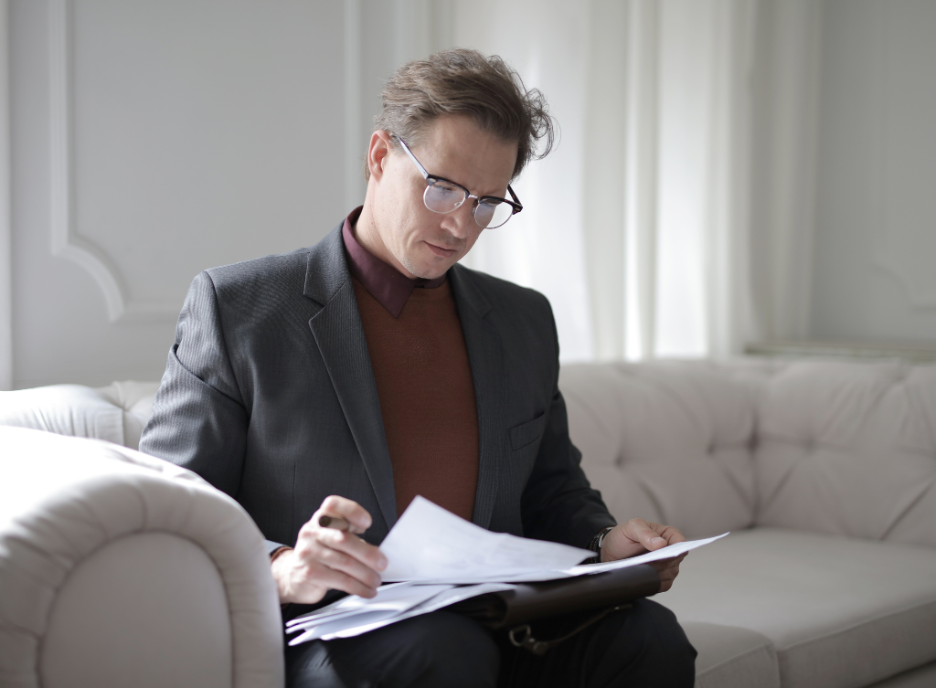 a lawyer reviewing documents on the couch