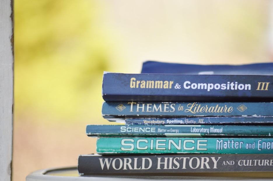 a pile of books related to English and grammar